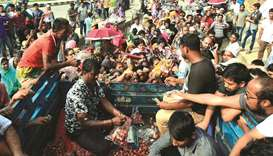 People scuffle as they purchase subsidised onions in Dhaka yesterday.