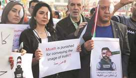 Palestinian journalists rally over wounding of colleague
