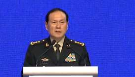 China calls on US to 'stop flexing muscles' in South China Sea