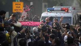 Supporters of Pakistan Muslim League-Nawaz (PML-N) sprinkle rose petals on a car carrying Former Pri