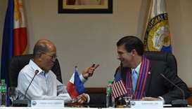 US Secretary of Defense Mark Esper (R) shakes hands with his Philippines counterpart Delfin Lorenzan