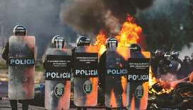 Bolivian riot police take position as supporters of Bolivian ex-president Evo Morales block a road i