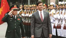 US Defence Secretary Mark Esper reviews the guard of honour with Vietnam's Defence Minister General