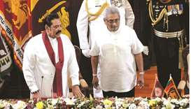 New Sri Lanka president swears in his brother as PM