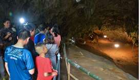 Chiang Rai Provincial Public Relations Office shows people visiting Tham Luang cave in the Mae Sai d