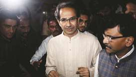 Shiv Sena chief Uddhav Thackeray leaves after a meeting with Nationalist Congress Party (NCP) and Co