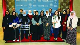 Fatma Hassan Alremaihi, Dr Amal al-Malki, and the Translation and Interpreting Institute team at Ajy
