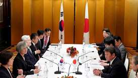 Japan's Foreign Minister Toshimitsu Motegi and South Korea's Foreign Minister Kang Kyung-wha attend