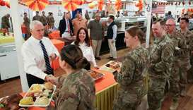 US Vice President Mike Pence and his wife Karen Pence help serve a Thanksgiving meal to US troops in