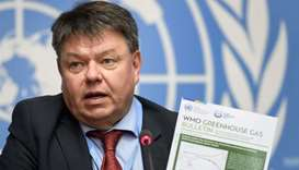 World Meteorological Organization (WMO) secretary-general Petteri Taalas shows the latest WMO Greenh