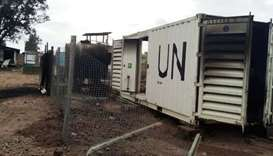 Burnt containers are seen at the United Nations (UN) civil base in Beni in the eastern part of the D