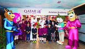 Officials at the opening of the Aviation Academy with children. Supplied picture