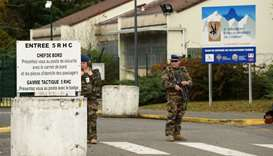 Soldiers stand at the entry of the 5th RHC (Fighter Helicopter Regiment) base, the regiment 7 of the