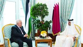 His Highness the Amir Sheikh Tamim bin Hamad al-Thani meets with Palestinian President Mahmoud Abbas