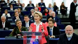 European Commission President-elect Ursula von der Leyen addresses the European Parliament next to E