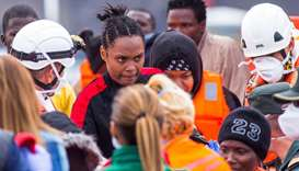 Migrants are seen on November 22 after arriving aboard a Spanish maritime rescue boat, after being r