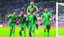 Iraq's players celebrate their victory during the 24th Arabian Gulf Cup Group A football match betwe