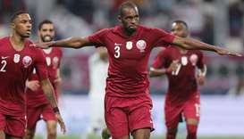 Qatar's defender Abdelkarim Hassan (C) celebrates after scoring during the 24th Arabian Gulf Cup Gro