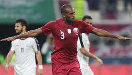 Qatar's defender Abdelkarim Hassan (C) celebrates after scoring