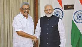 Sri Lanka's President Gotabaya Rajapaksa and India's Prime Minister Narendra Modi shake hands during