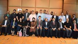 Renowned trainer, Kwong Yue Yang is flanked by members and officials of the IIA Doha Chapter during