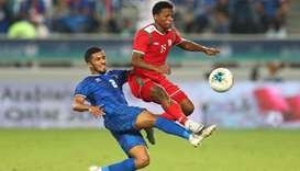 Oman's Al Mandhar Al Alawi in action with Kuwait's Sami Al-Sanea
