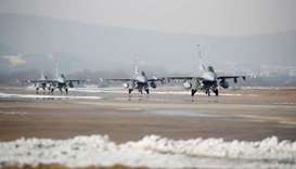 US Air Force F-16 fighter jets take part in a joint aerial drill exercise called 'Vigilant Ace' betw