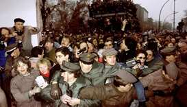 In this file photo taken on November 12, 1989 East and West German Police contain the crowd of East