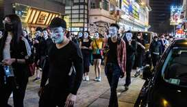Protesters wearing a Guy Fawkes mask - after the British Catholic rebel who attempted to blow up par