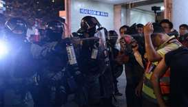Police use pepper spray in a residential area after a rally in the Tseung Kwan O district in Hong Ko