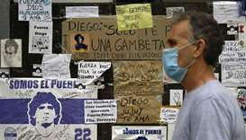 Messages of support are seen outside the private clinic where Argentine former football star and coa