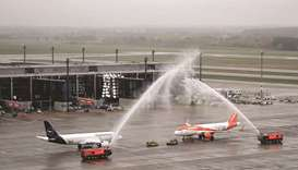 Fire engines spray water to greet Lufthansa and Easyjet aircraft, the first ones to arrive at 'Berli