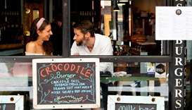 People dine at a cafe after coronavirus disease restrictions were eased for the state of Victoria, i