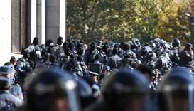 Law enforcement officers are seen during an opposition rally to demand the resignation of Armenian P