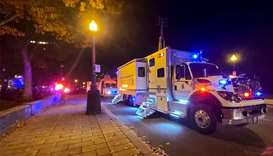 A Police truck is parked near the National Assembly of Quebec, in Quebec City, early Sunday, after t