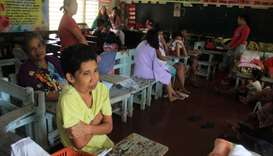 Residents shelter in a classroom used as an evacuation centre in Camalig town, Albay province, ahead
