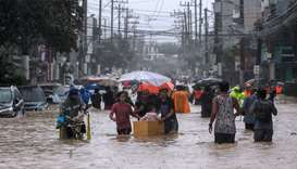 Residents evacuate from their flooded communities as Typhoon Vamco batters the Philippine capital, i