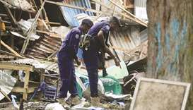 Somali policemen are seen at the scene of a suicide explosion at a restaurant near a police academy,