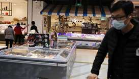 Man at the frozen food section of a supermarket in Beijing