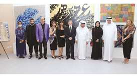 Artists and organisers with Sheikh Faisal bin Qassim al-Thani at the exhibition