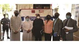Qatari and Liberian officials attend the delivery event.