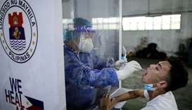 A vendor at Pritil Public Market gets a free swab test amid the coronavirus disease (COVID-19) outbr