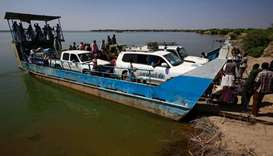 United Nations Children's Fund (UNICEF) cars arrive by ferry boat to the Village 8 border reception
