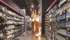 Products burn at a Carrefour supermarket in Sao Paulo after rioters invaded the place during a prote