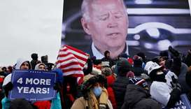 Democratic U.S. presidential nominee and former Vice President Joe Biden is seen on a screen as supp