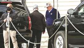 President Donald Trump wears golf shoes as he departs the White House in Washington, US.