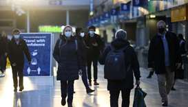 People walk through Waterloo station, amid the coronavirus disease outbreak, in London yesterday.