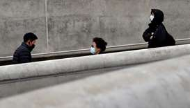 People wearing masks walk along a street amid the coronavirus disease pandemic in Seoul, South Korea