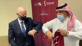 Gulf Times Editor-in-Chief Faisal Abdulhameed al-Mudahka with the FIFA President Gianni Infantino.