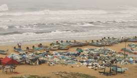 Boats are seen parked on deserted Marina beach during rains before Cyclone Nivar's landfall, in Chen